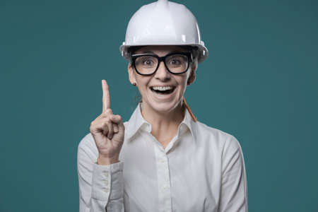 Cheerful happy woman smiling and pointing upwards, ideas and creativity concept