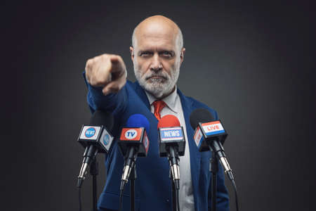 Polician pointing to the audience during the press conference, election campaign concept