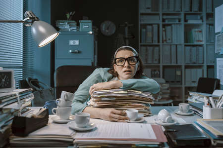 Stressed panicked employee working late at night in the office, she had too much coffee