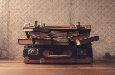 Vintage suitcase full of old books and novels, travel and reading concept Archivio Fotografico