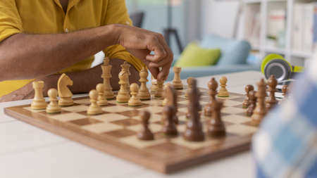 Two men playing chess at home, strategy games and competition concept 版權商用圖片