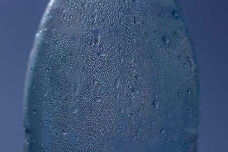 Drops flow down the wall of a water bottle. Drinking Water Bottle