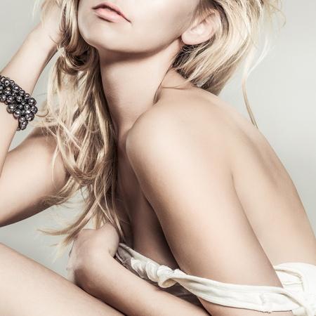 sexy nude blonde: Fashion portrait of young beautiful woman  posing in studio