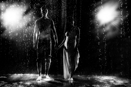 naked man: Black and white abstract fashion portrait of young beautiful pair in the rain Stock Photo