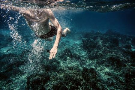 model fish: Underwater photo of swimming man