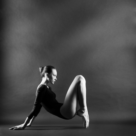 A portrait of young beautiful gymnast woman photo