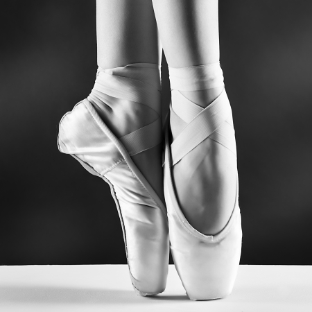 ballet shoes: A photo of ballerinas pointes on black background
