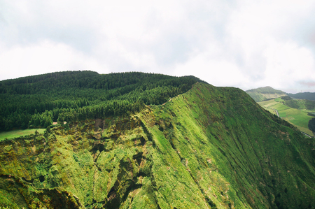 sightsee: Green mountain hills with forest, Azores, Portugal