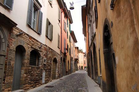 sightsee: Small Italian street with old houses, Bergamo Stock Photo