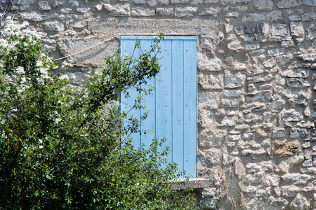 windows frame: Typical colored window at Moustiers Sainte-Marie in Provence, France