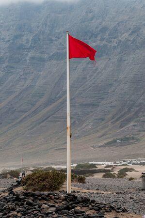 red flag on a beach