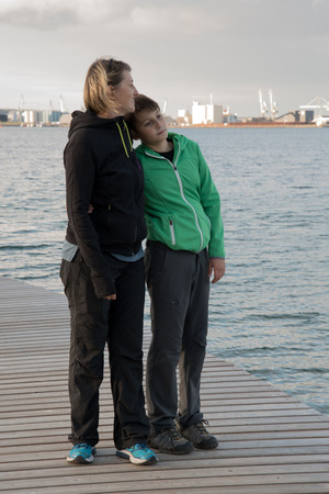 Mother and son hugged on the Infinity Bridge in Aarhus Denmark Stock Photo