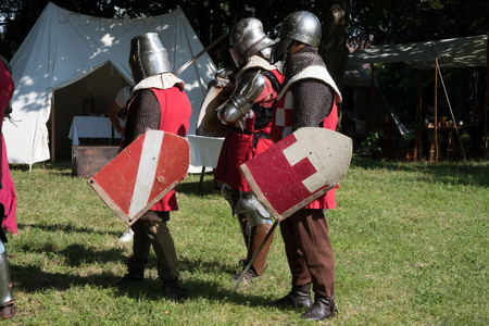 medieval historical re-enactment with men in armor .