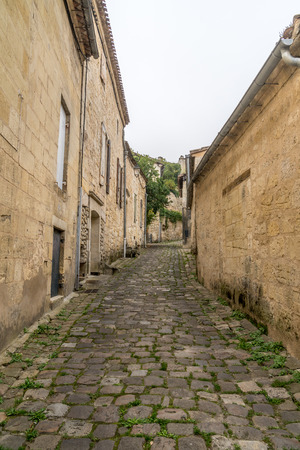 ancient street made of stone named Rue de la Port Saint-Martin, in Saint-Emilion, France.