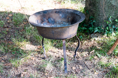 Bronze brazier of the Middle Ages during a historic re-enactment.