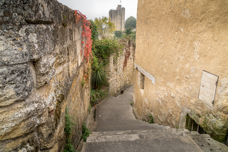 ancient street made of stone named Rue de la Port Saint-Martin, in Saint-Emilion, France.