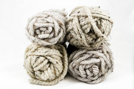 yarn: Four skeins of chunky, neutral colored wool yarn