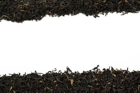 loose leaf: Loose leaf black tea against a white background with room for text