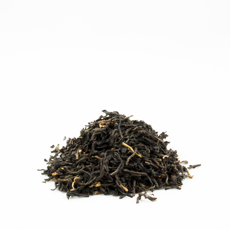 plant antioxidants: A pile of loose leave black tea against an isolated white background with room for text.
