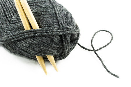 knitting needles: Ball of gray yarn with wood knitting needles