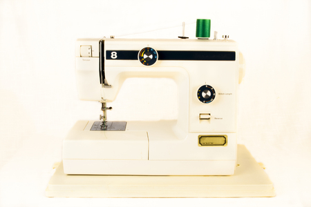 stitching machine: Vintage sewing machine with green thread spool. Retro style Stock Photo
