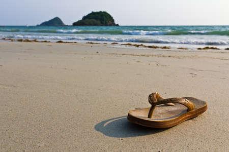 Sandals, flip-flops on the beach Stock Photo - 9141541