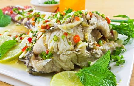 Spicy steamed fish fillet with chopped chillis healthy food Stockfoto