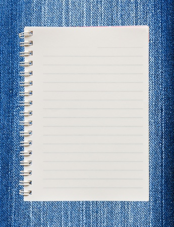 Blank paper with on  blue jeans background photo