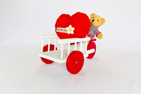 Red heart and bear on a tricycle. Stock Photo - 9602873
