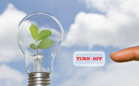 A hand presses a virtual button turn off energy Stockfoto