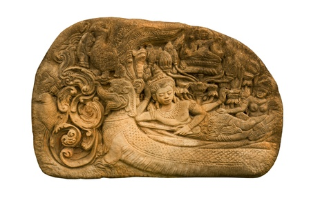 Carved sandstone  king bed on the back of Dragon the old wall.The old castle in Thailand photo