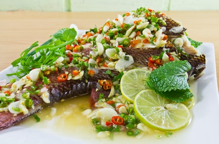Spicy steamed fish fillet with chopped chillis healthy food Stock Photo - 10107647