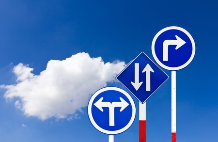 Curved Road Traffic Sign over blue sky,turn right photo