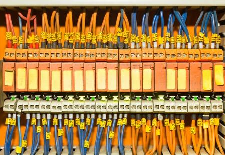 Set of Orange terminal blocks located inside of a control panel