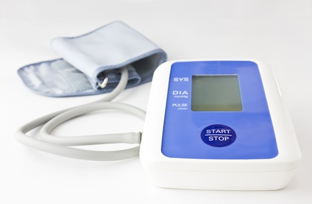 Automatic digital blood pressure  on white background photo
