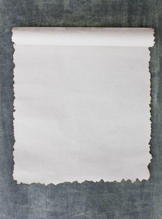 page down: Vintage grunge burnt paper on blackboard  background Stock Photo