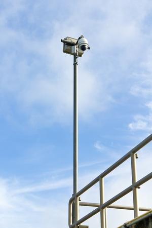 Dome CCTV camera against the blue sky Stock Photo - 10586612