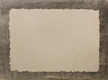 Vintage grunge burnt paper on brown background photo