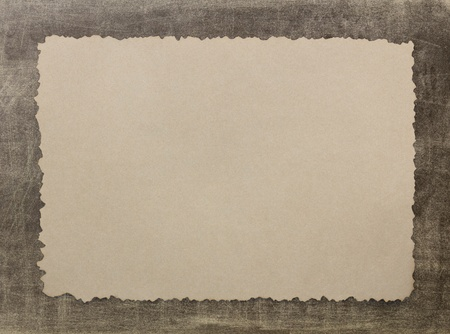 Vintage grunge burnt paper on brown background