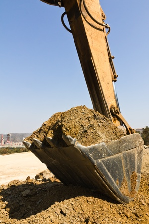 excavator loader during earthmoving works outdoors  at the quarry Stock Photo - 10658305