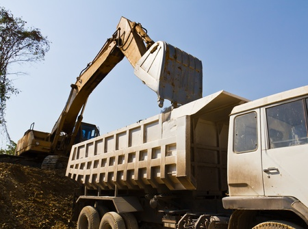 Excavator loader and truck during earthmoving works outdoors  at the quarry Stock Photo - 10658292