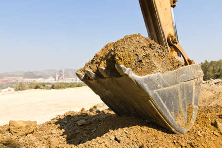 excavator loader during earthmoving works outdoors  at the quarry Stock Photo - 10658301