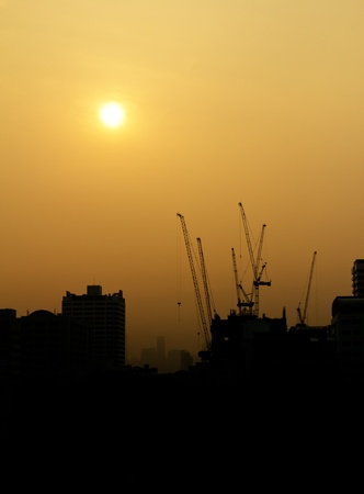 City under construction at sunrise silhouette photo