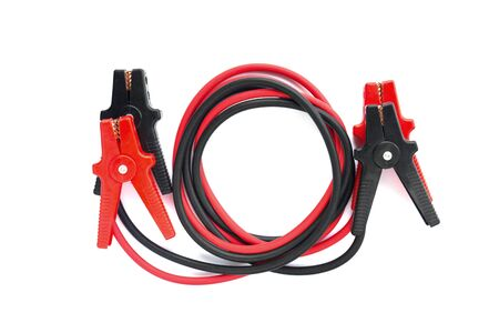 Car battery jumper cables over white background photo