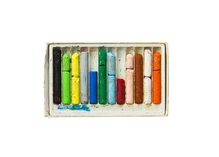 Used colored wax crayons with isolated on white photo