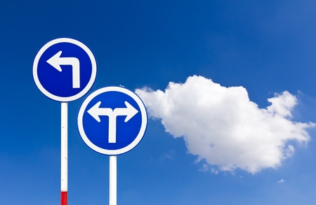 Curved Road Traffic Sign over blue sky,turn left photo