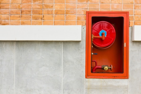Hydrant with water hoses and fire extinguish equipment on wall