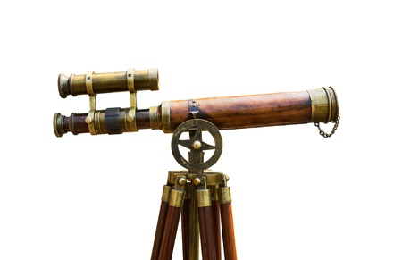 Antique brass telescope on white background photo