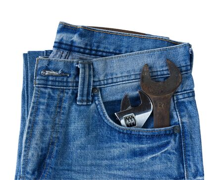Blue jeans pocket with old tool on white background photo