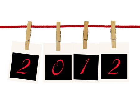 Photo frames 2012 hang by wooden peg on white background photo
